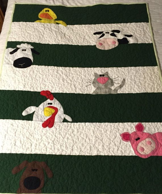 Darling Farm Animal Baby Quilt ready to be adored and loved by a little one. This quilt features embroidered animals that can easily be found on a farm.  The animals are machine appliqued with buttons for eyes and nostrils. Additional embroidery details help add to they whimsy of the farm animals. Cant you just imagine them peering over fences?  This quilt front is made of 100% cotton flannel. The animals are an adaption of Amy Bradleys Animal Whimsy pattern. This quilt is handmade with all…