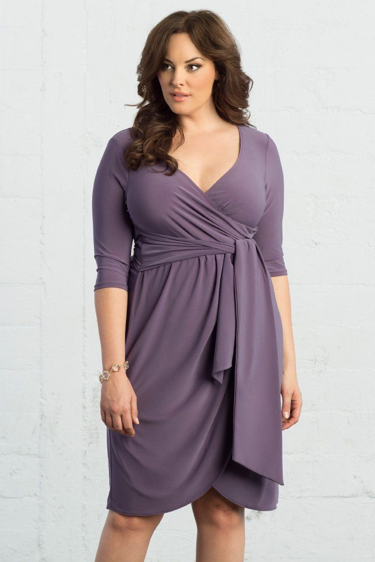 Our plus size Harlow Faux Wrap Dress is perfect to wear to weddings, dates, special dinners and semi-formal events. This flattering dress comes with a wide tie you can adjust. Made exclusively for women's plus sizes. Available in other colors. Shop our entire collection of cocktail dresses at www.kiyonna.com