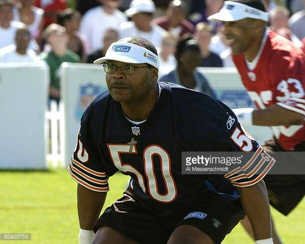 """Mike Singletary in a """"Legends"""" flag football game."""
