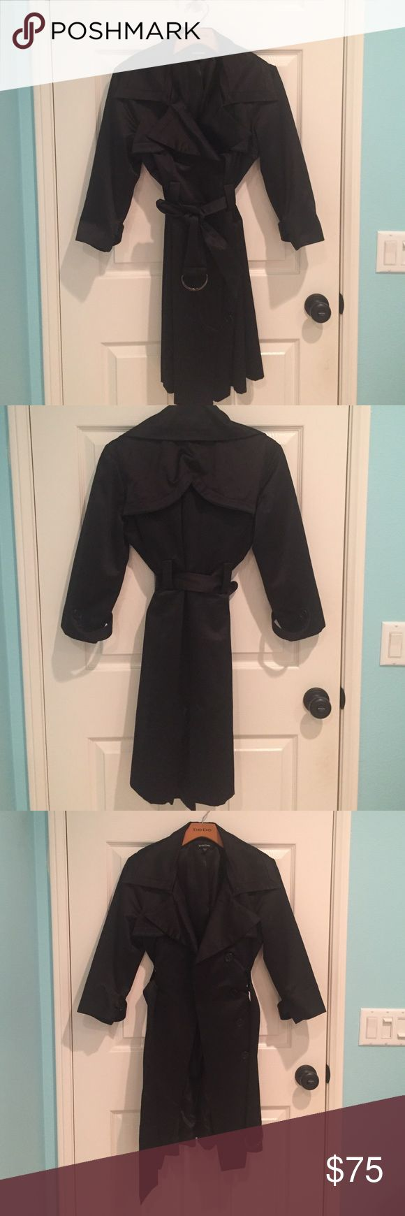 Bebe 3/4 trench jacket or dress Bebe trench 3/4 sleeve jacket. 6 buttons on front, belt can be tied or looped around 2 prong clip. Back has slit of 6 inches. Double adhesive tape can be applied to slit and worn as a dress! Double duty. Worn with great care. Medium size, length about 35 inches. I am 64 inches height and it hits right above knee. bebe Jackets & Coats Trench Coats