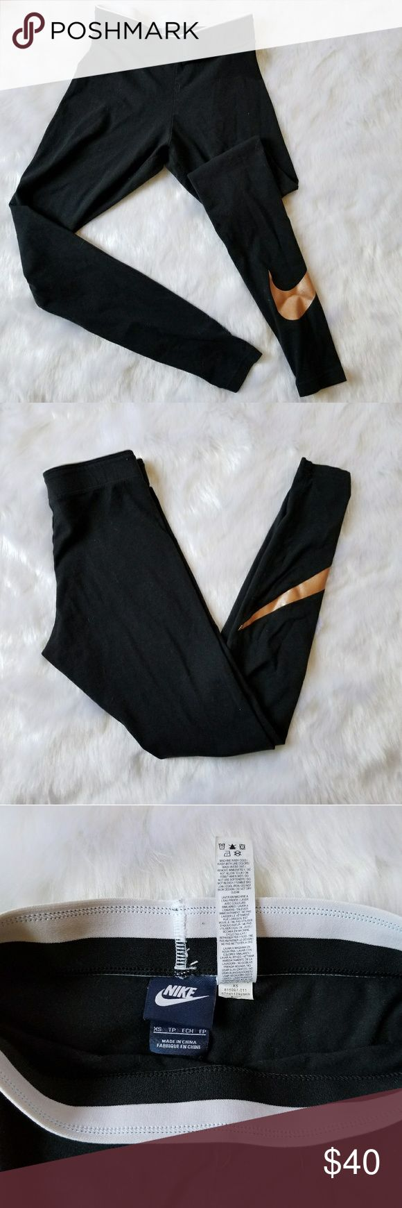 """Nike Gold Swoosh Active Leggings Super cute Nike legging with gold check  Love the contrast of the gold and black  No flaws Only tried on didn't fit me sadly Will fit between XS-S Im 5'1"""" and did not fit me cropped Nike Pants Leggings"""