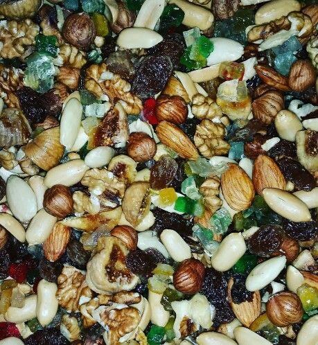 "Peanut, almonds, raisin and chocolate mixture for Italian traditional Christmas cake: the Emilia Romagna ""Panone"""