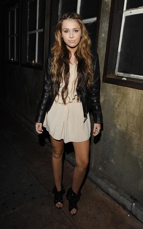 Miley Cyrus wearing Alexander Wang Freja Lace-Up Booties Isabel Marant Dress BCBG PLEATED-HEM LEATHER JACKET