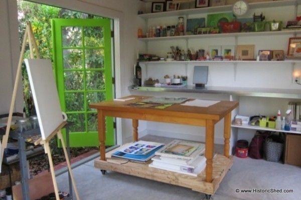 rolling artist table http://historicshed.com/2013/05/a-sunny-artist-studio-shed/