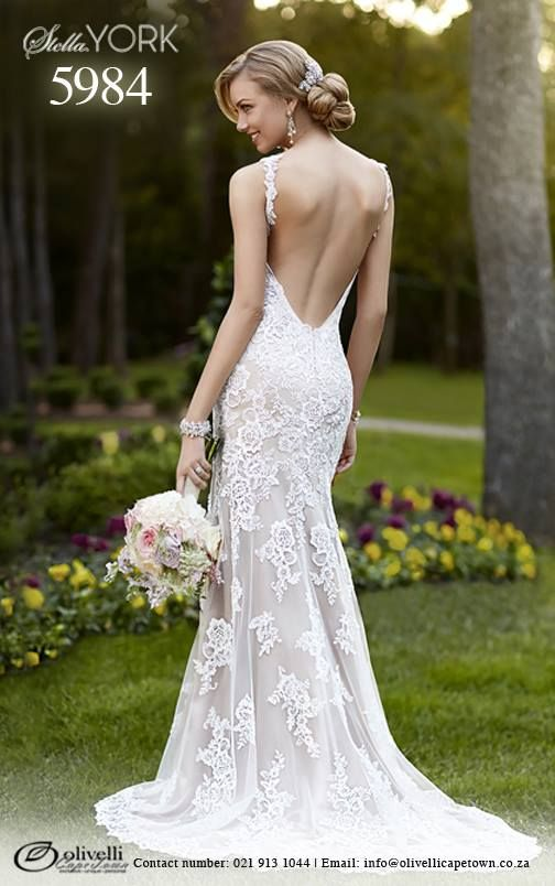 Another gorgeous Lace over Lustre Satin Sheath, red carpet inspired, dress by Stella York. Style 5984 has beautiful vine shoulder straps, a sweep train and low back with a zipper closure that will hug your curves while the V neckline highlights your beautiful face. #StellaYork #OlivelliCT #Wedding #Gown #Dress