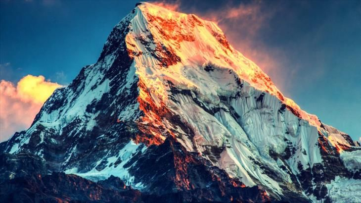 Mount Everest's peak marks the border between China and Nepal.