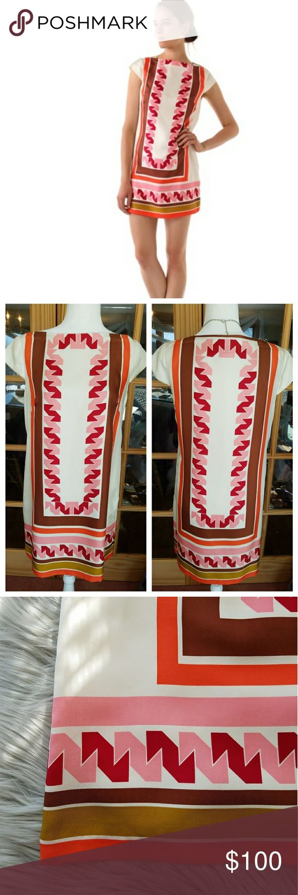 "🎉HP 2-4🎉Milly NY 100% Silk Print Shift Dress This is an absolutely gorgeous Milly of New York shift dress!. This print is a beautiful Aztec-like design with a lovely palette of pink, red, tangerine, warm brown, and a golden olive shade. This would be a lovely special occasion dress!. And would be a beautiful 3 season dress for some! Also has side zip, cap sleeves, and completely lined. Bust is approximately 18.5"", Length is 33.5"". In excellent gently used condition. Size 8. Milly of New…"