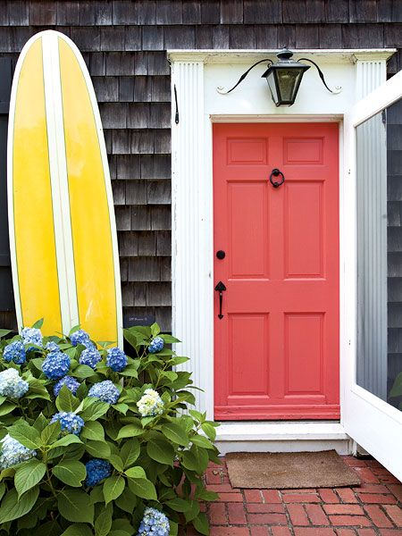 Coral door, lantern, wood shingles, surfboard, blue hydrangeas