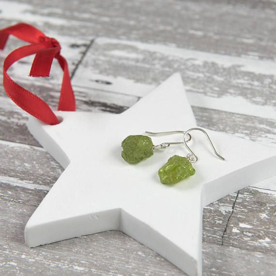 Raw Peridot Earrings/ Genuine Peridot Earrings/Peridot Earring Sterling Silver /Natural Peridot Earring/ August Birthstone earrings  these are Genuine, natural raw Peridot gemstones they vary in size between 5 and 10 MM - each one is unique. You might not receive the stone pictured, but it