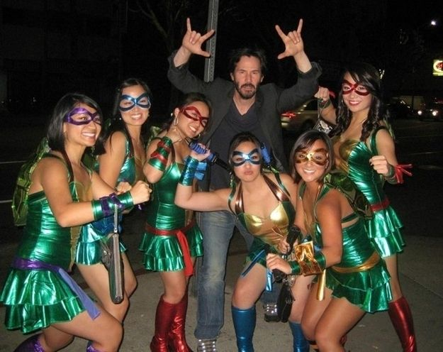Keanu Reeves photobombing a bunch of drunk girls dressed as Ninja Turtles.   The 30 Most Powerful Photobombs Of TheYear