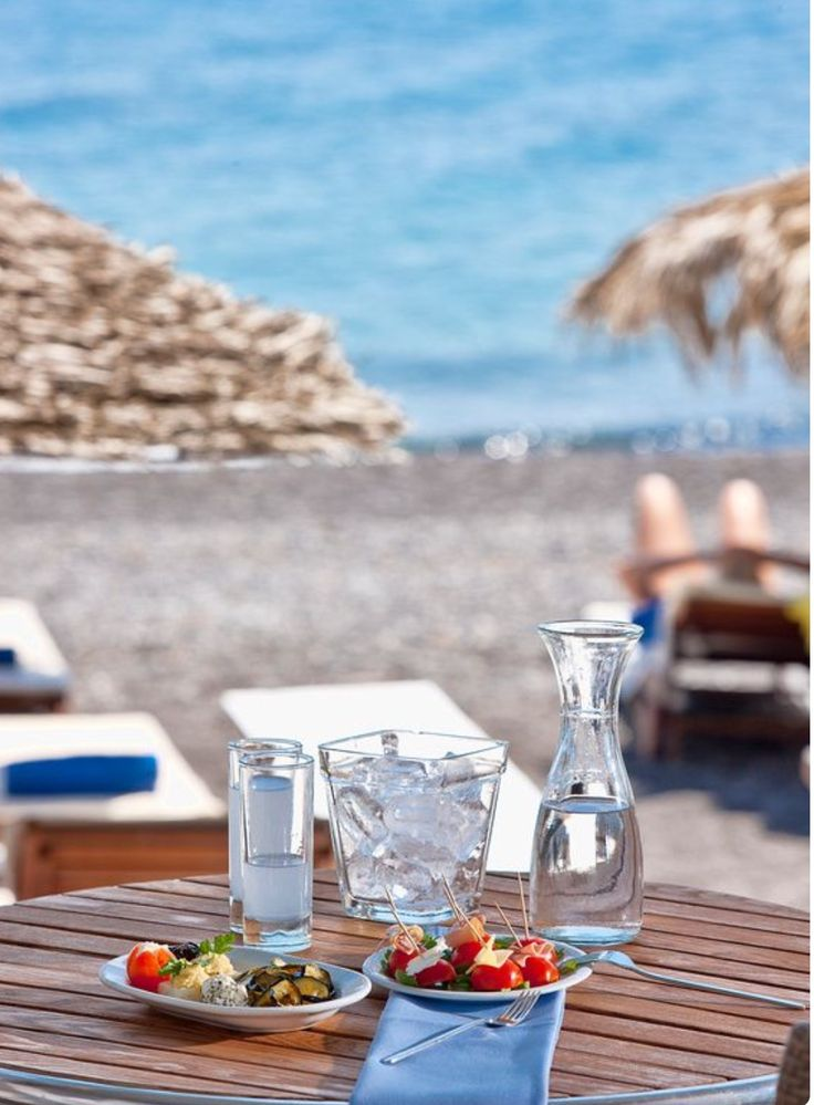 Ouzo at the beach. Santorini island, Greece - Selected by www.oiamansion.com