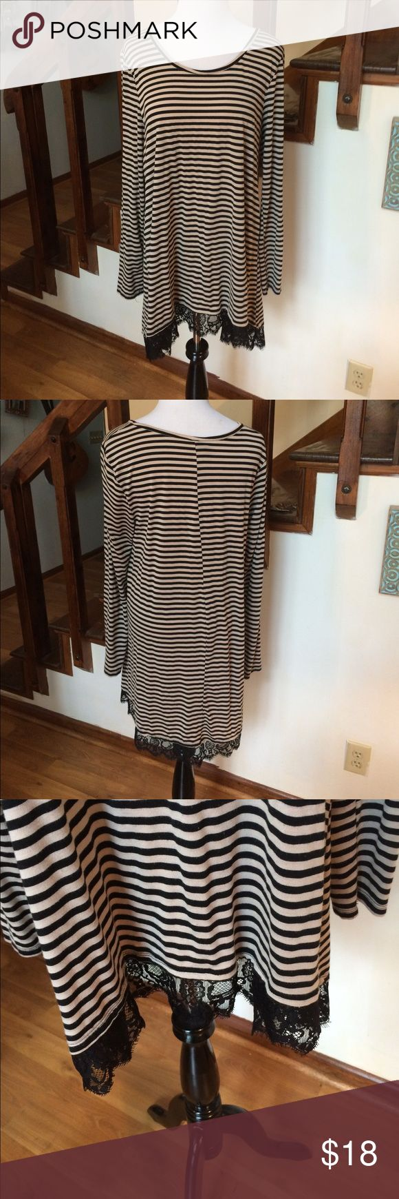 Knit Stripe Top with Black Lace Accent This dress op can be worn as a short dress or Tunic with leggings soft knot fabric and pretty lace accent at hem Massini Tops Blouses