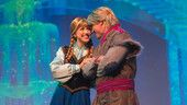 Elsa and Kristoff embracing during For the First Time in Forever: A Frozen Sing-Along Celebration