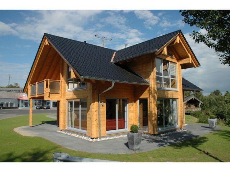 Sommerwiese einfamilienhaus von fullwood lk fertigbau for Blockhaus modern
