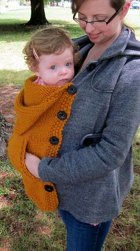*You could probably repurpose an old sweater to button for this. You would run buttons down one side of your baby sling ... it would then button into the sweater mama is wearing; mamas sweater buttons on one side, babies sweater buttons on the other.