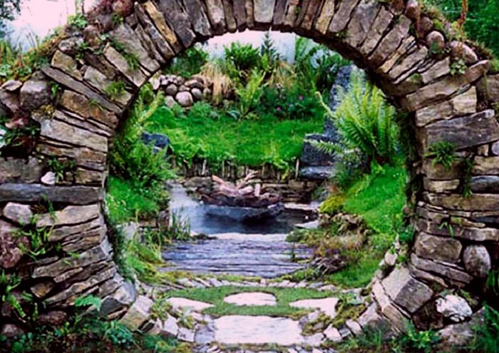 """Moon gate, built of unmortared granite blocks, built in 1996 by Dave Araneo ofMassachusetts.""""It's is one of the oldest technologies around,"""" Dave says. """"You build a wood form, place the stones to either side, and build up. Then you finish with a keystone and remove the form. There is a wonderful energy to these structures."""""""
