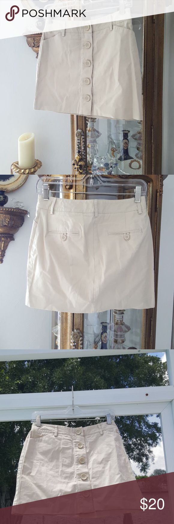 EXPRESS Khaki Tan Button Mini Skirt Sz.2 Great condition! Size 2. Super CUTE A-Line Semi High Waisted Skirt With Buttons. Would look sooooo cute with your favorite crop top, or a plain white t-shirt! Flip flops, heels or boots! Material has a bit of stretch. 96% COTTON 4% LYCRA SPANDEX. Please see photos. Express Skirts Mini