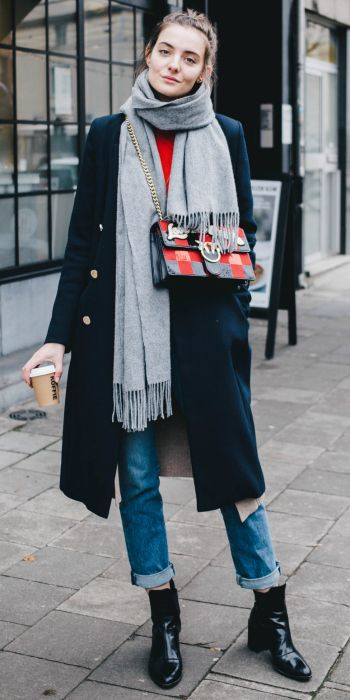 Paulien Riemis + cute and casual + stylish winter look + rolled denim jeans + double breasted navy overcoat + pair of striking patent leather boots.   Tee: H&M, Cardigan/Boots: Zara, Coat: River Island, Bag: Pinko.