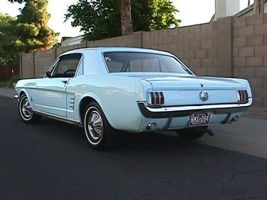 1966 mustang - first car I remember our family having - I was about 4.  It was souped up and my folks took it drag racing on weekends...baby blue, pony edition.  Wish they never got rid of it.