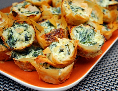Spanakopita bites: spinach and cheeses nestled in flaky phyllo dough and baked :)
