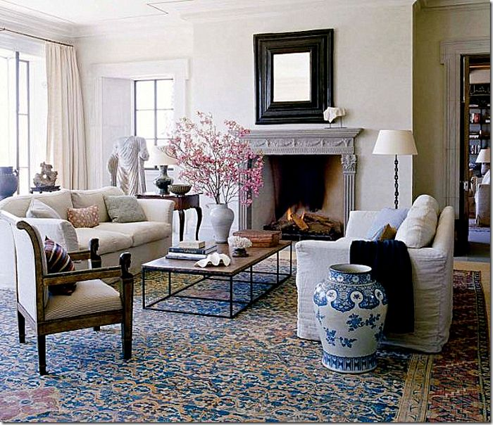 Matt Camron Rugs & Tapestries: Michael Smith layers a beautiful antique Persian rug over a large piece of seagrass.  Notice how the rug is the only pattern in the room.