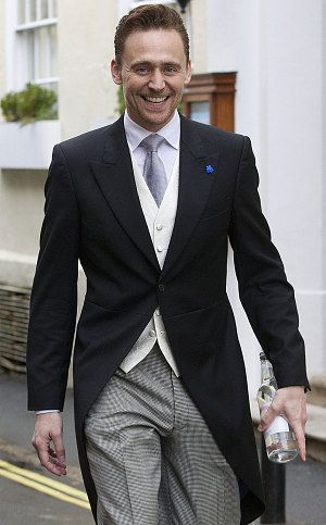 Tom Hiddleston in a morning suit on the way to the Cumberbatch wedding.. Lovely.