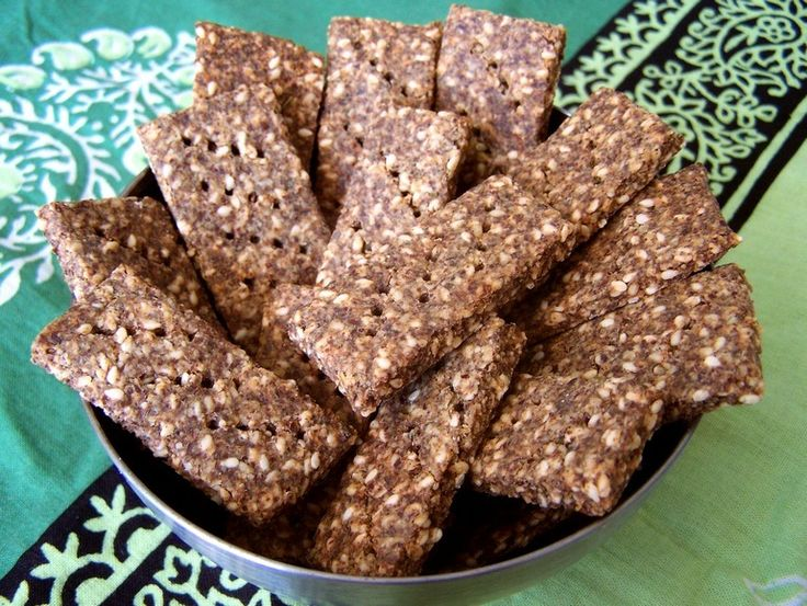Savory Flax Crackers - ground flax, almond/other nut/seed flour, sesame seeds, nutritional yeast flakes, dried herbs (e.g. rosemary, sage, thyme, etc.), salt, soy sauce/Marmite (might sub tamari), water