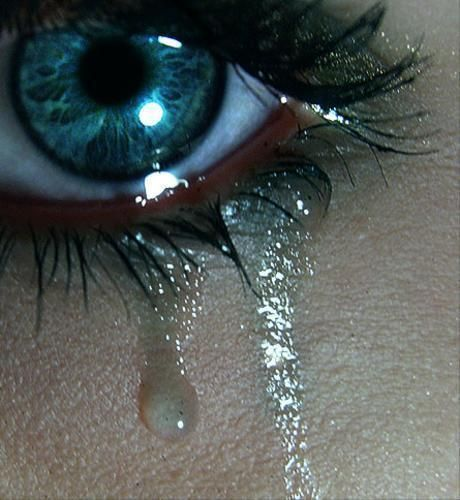 Teary washed out blue eyes