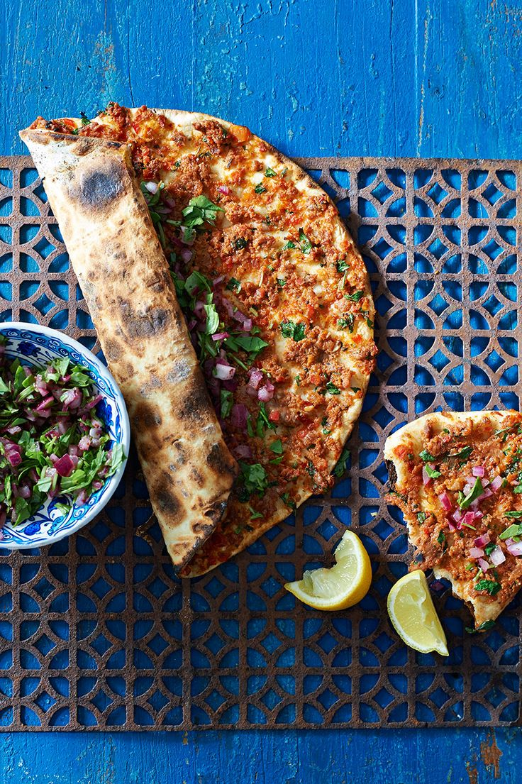 Thin-crust pide bread with spicy lamb topping