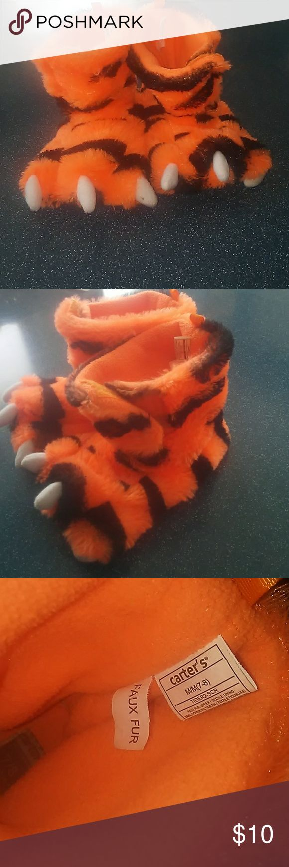 Carter's Toddler Tiger Stripe Slippers Carter's Toddler size 7/8 (Medium) tiger stripe slippers. Faux fur. Fun slippers my son loved playing around in. These have been worn, many many times. In good shape but by no means perfect condition- definitely used. I hope someone else can love them as much as we have! Carter's Shoes Slippers
