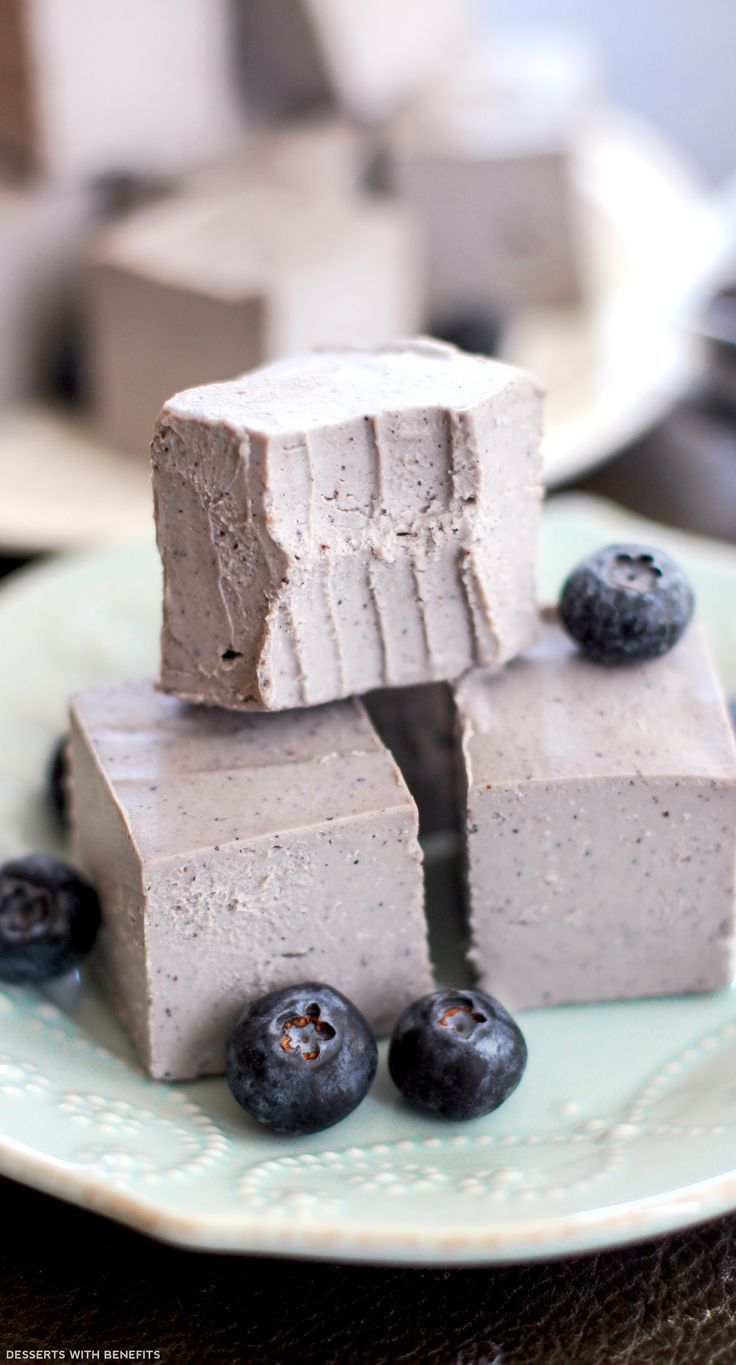 Healthy Raw Blueberry Coconut Fudge -- creamy, silky, fudgy bites of berry coconutty deliciousness. They're sweet, they're addictive, and they come in an adorable little package. (refined sugar free, low carb, gluten free, dairy free, vegan)