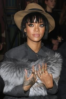 Singer Rihanna poses before the Lanvin Fall-Winter 2014-2015 women's ready-to-wear collection show during Paris Fashion Week February 27, 2014. REUTERS-Benoit Tessier