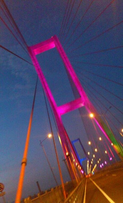 Suramadu Bridge, the bridge that connects Surabaya and Madura. Changing colors lighting made the bridge looks stunning at night.