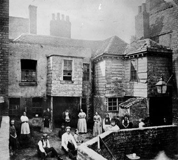 Market Court, Kensington High Street, London typifies the squalor of many of the slum courtyards of  urban Victorian England