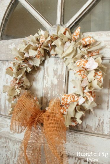 Looks so easy to make, rounded wire coat hanger, strips of fall materials tied on coat hanger with a bow, so pretty !!!
