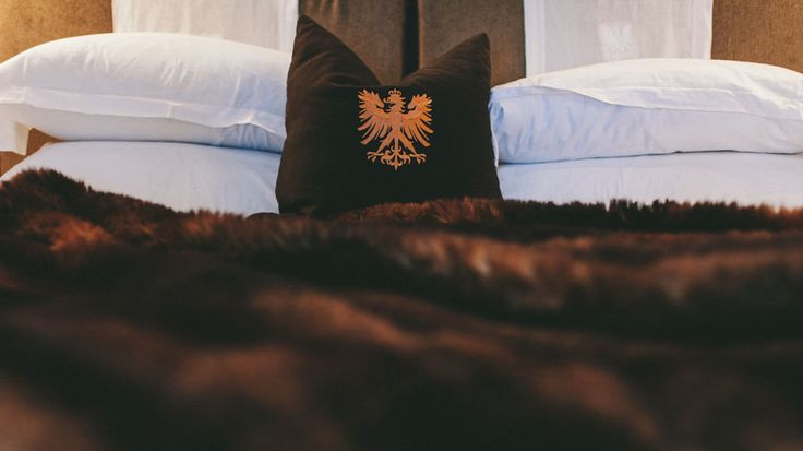 """Experience the """"Cloud"""" Feather Down Bed Topper by HotelHome for yourself at the enchanting and elegant Eichardts Hotel in Queenstown NZ. #thecloud #hotelhome #bedtopper #mattresstopper"""