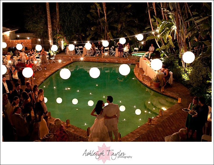 #reception - string lights and paper lanterns over the pool! #wedding by www.ashleightaylorphotography.com