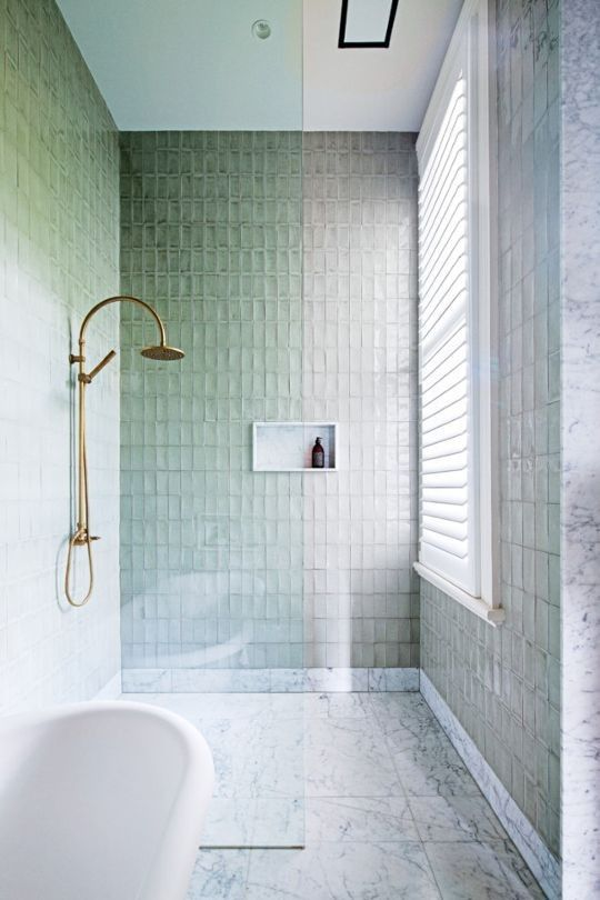 House tour: the revival of a Victorian era home in Melbourne's Prahran: In the bathroom, OMVIVO 'Latis' basin; Izé light fittings; and Yokato tapware. Handmade shower tiles from Stonetile Industry.