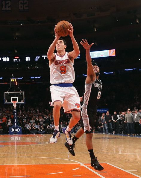 Pablo Prigioni #9 of the New York Knicks goes up to score two against the San Antonio Spurs at Madison Square Garden on January 3, 2013 in New York City.