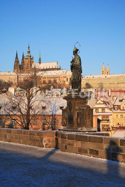 Prague Castle from the Charles Bridge with the statue of Saint John Nepomuk, Prague, Czech Republic