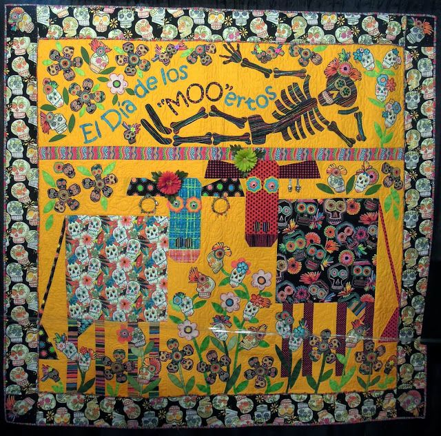 """Dia de los MOOertos"" by Peggy Baldwin-Clayton,  quilted by Denise Green.  2013 Houston IQF, ""MOO-ston"" exhibit. Photo by Quilt Inspiration."