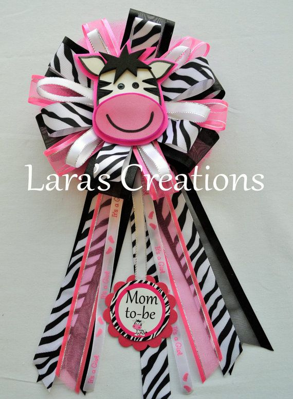Baby Shower Corsage. Solid pink, black, and zebra print ribbon used. Hand made foam zebra in center. This corsage comes personalized with Mom