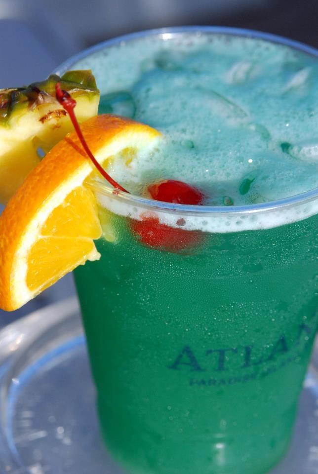 Leprechaun Lemonade ~(Atlantis Resort)  Ingredients: 1 1/2 oz. Absolut Vodka 1 oz Apple Pucker or Granny smith Green Apple Monin Syrup, Midori Melon Liquor can also be used.  4 oz. Sweet and Sour Mix or Lemonade   1/4 oz Simple Syrup.  Directions: Add all ingredients in a cocktail shaker wth ice. Shake well, serve on the rocks and Enjoy!