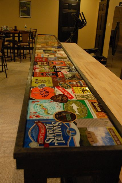 Top 40 Best Home Bar Designs And Ideas For Men: Bar Top. (Six Pack Cartons And Beer Memorabilia With Layer Of Epoxy.)