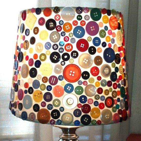 Cheap lampshade + random buttons + glue = quirky and unique hand crafted light adornment wonder!! Could use a different item for boys or girls room