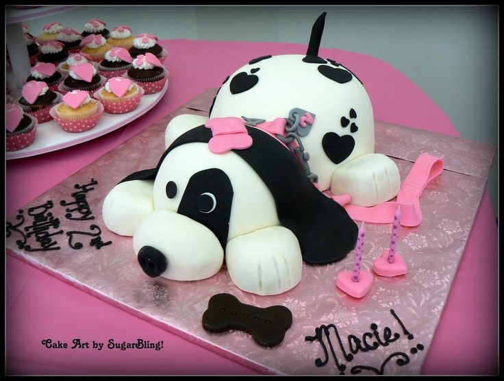 This is a puppy Cake I made for a darling little girl turning 2!  The cake was carved and covered in fondant and then all of the details were made from fondant or sugarpaste.This custom cake was created by SugarBling! - a cake boutique located in Kansas City, Missouri.
