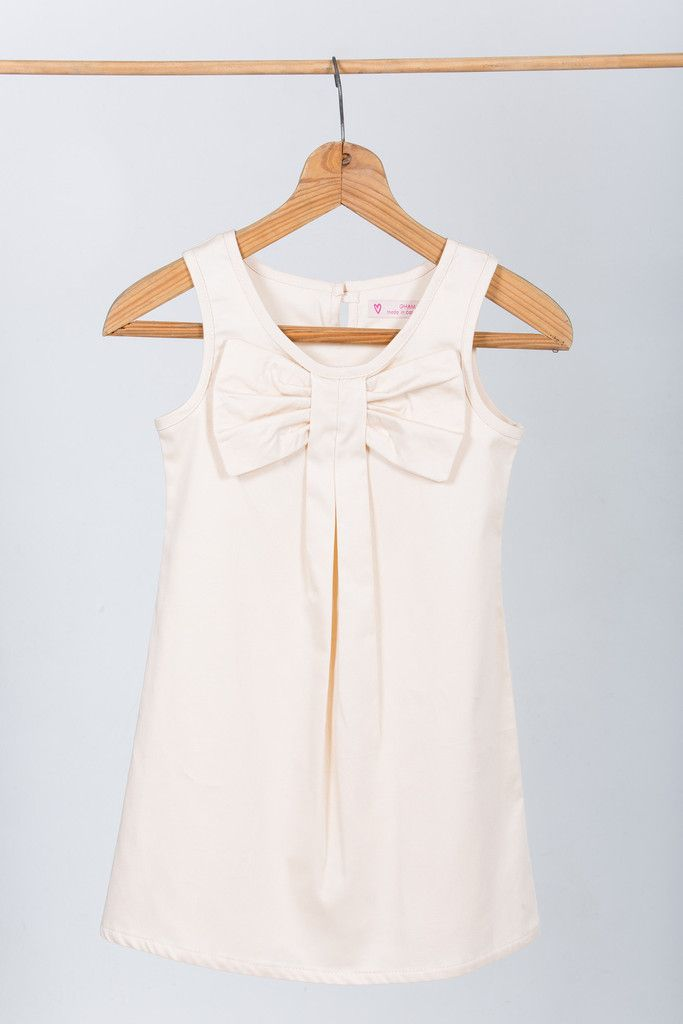 """Flower girl dress: """"Ella"""" made by GHAM. Price: R599. A beautiful ivory cotton slip dress. Accentuated with a cheeky bow and pleats. Cape Town, South Africa."""