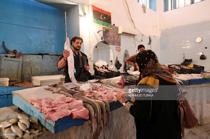 A Libyan woman shops for fish in the capital Tripoli on June 6, 2016, prior to Iftar, or breaking of the daylong fast, on the first day of the holy month of Ramadan. Islamic authorities across much of the world -- from the most populous Muslim-majority country Indonesia to Saudi Arabia, home to the faith's holiest sites -- announced the start of the fasting month with the sighting of the crescent moon. Marking the divine revelation received by Islam's Prophet Mohammed, the month sees Muslim…