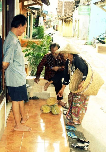 a lady vendor selling durians fruit