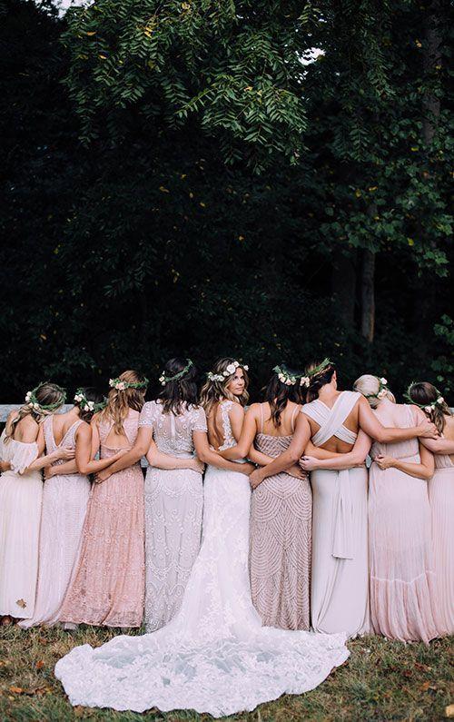A bride with boho bridesmaids in glittering dresses | Brides.com